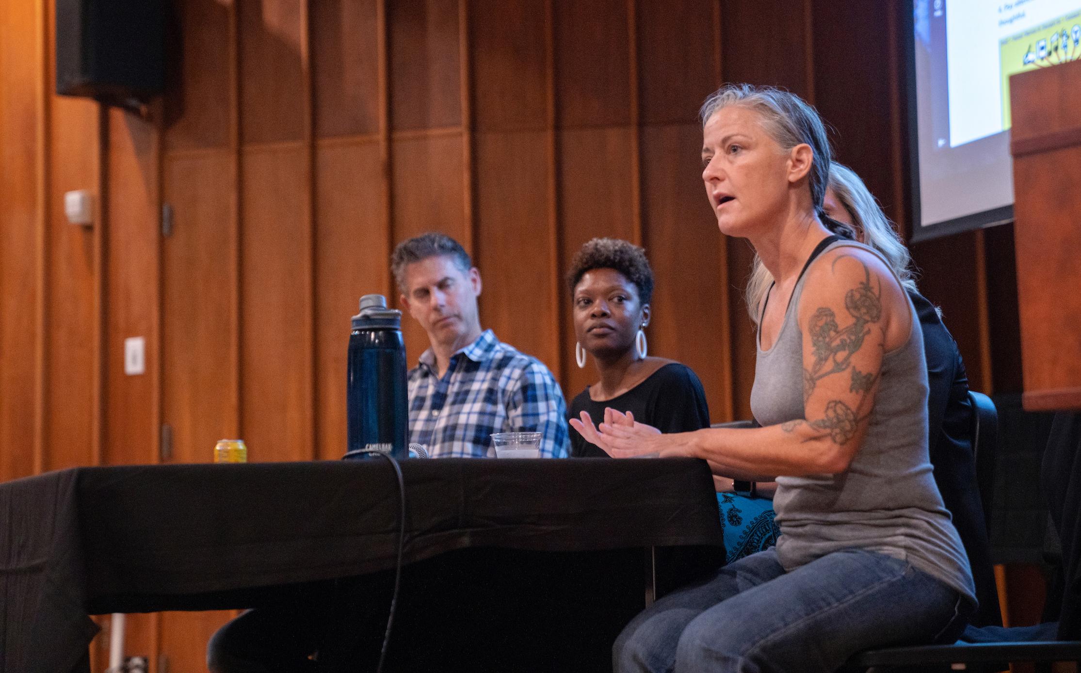 woman speaking at panel