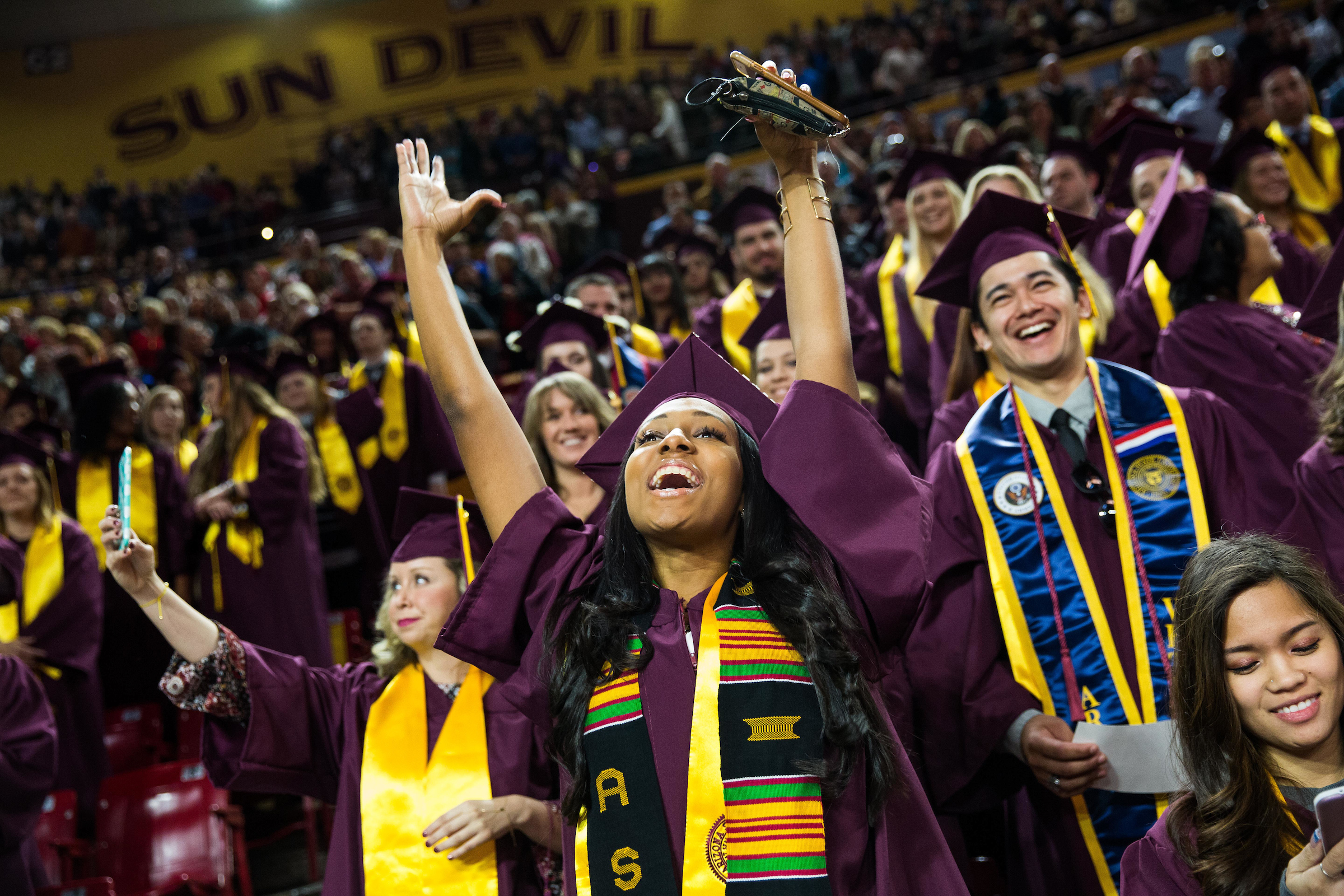 student celebrating at ASU commencement