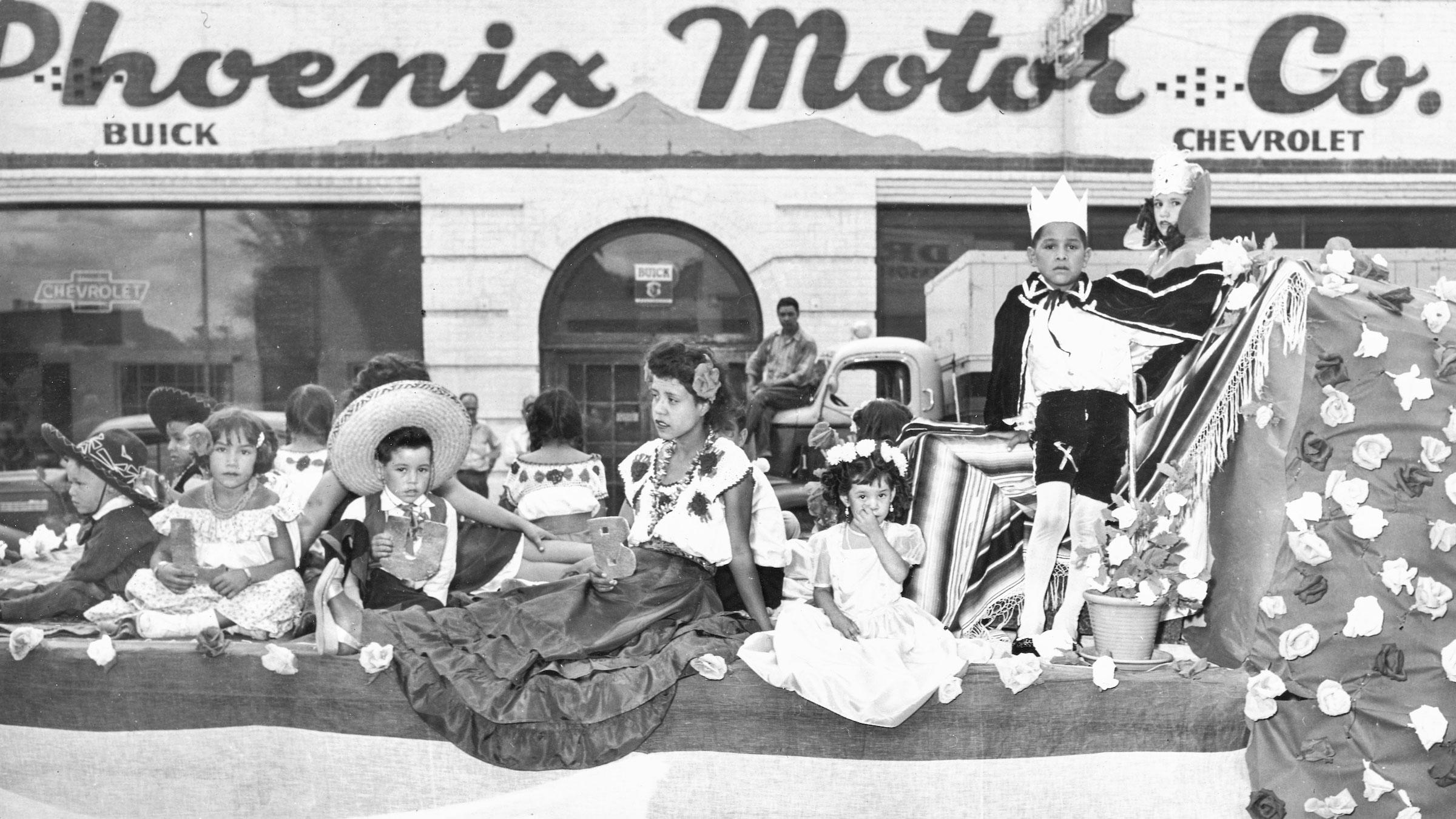 Children ride in a parade in midcentury Phoenix