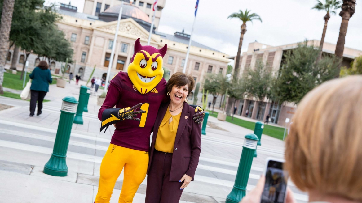 Sparky poses with a legislator at Day at the Capitol