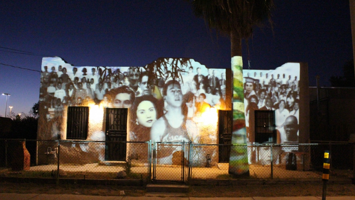 Photo projections on a historic building in Barrio Anita.