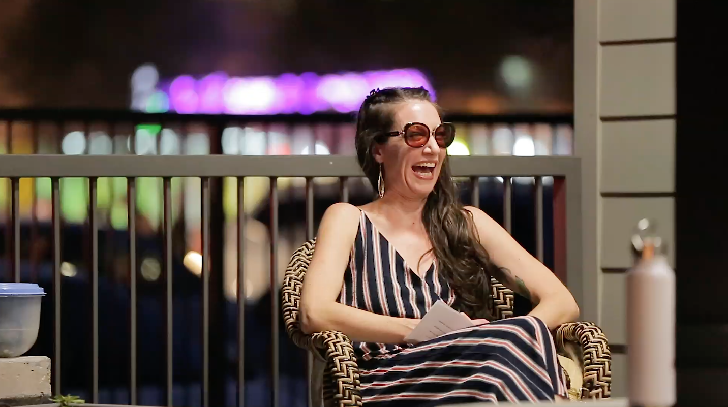 woman sitting in chair laughing
