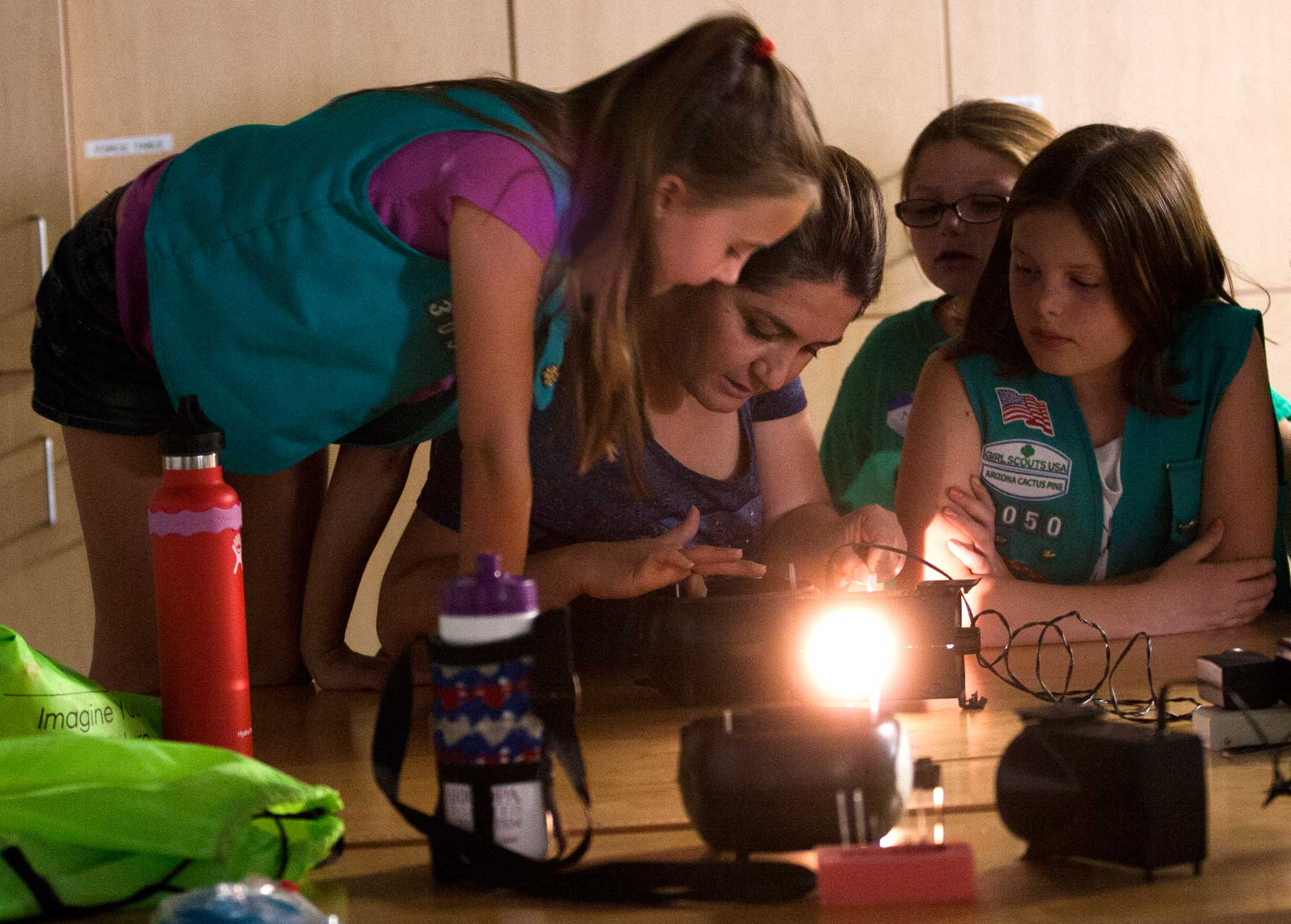 Girl Scouts study model of the human eye at ASU Polytechnic campus