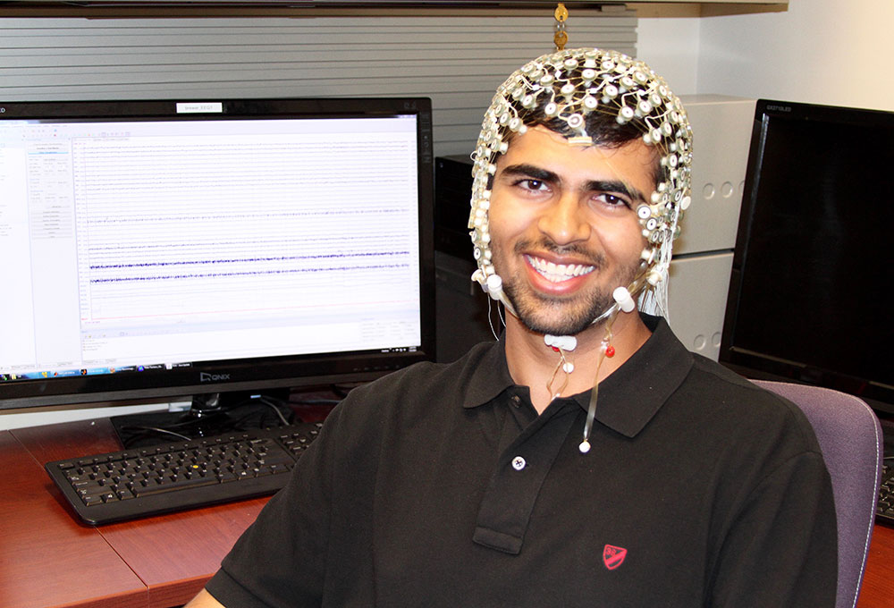 student wearing EEG cap