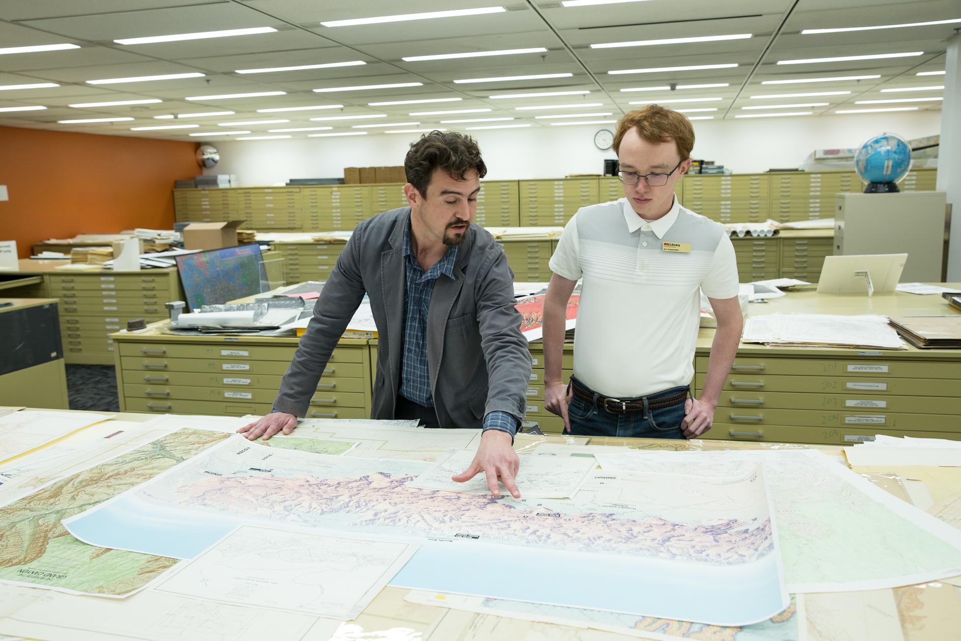 Matt Toro ASU examines Grand Canyon maps