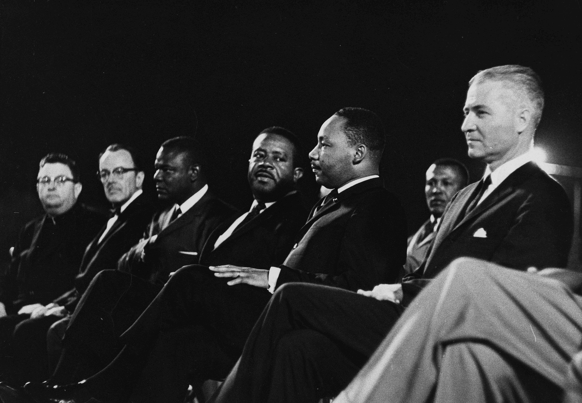 MLK and other men sitting in a row