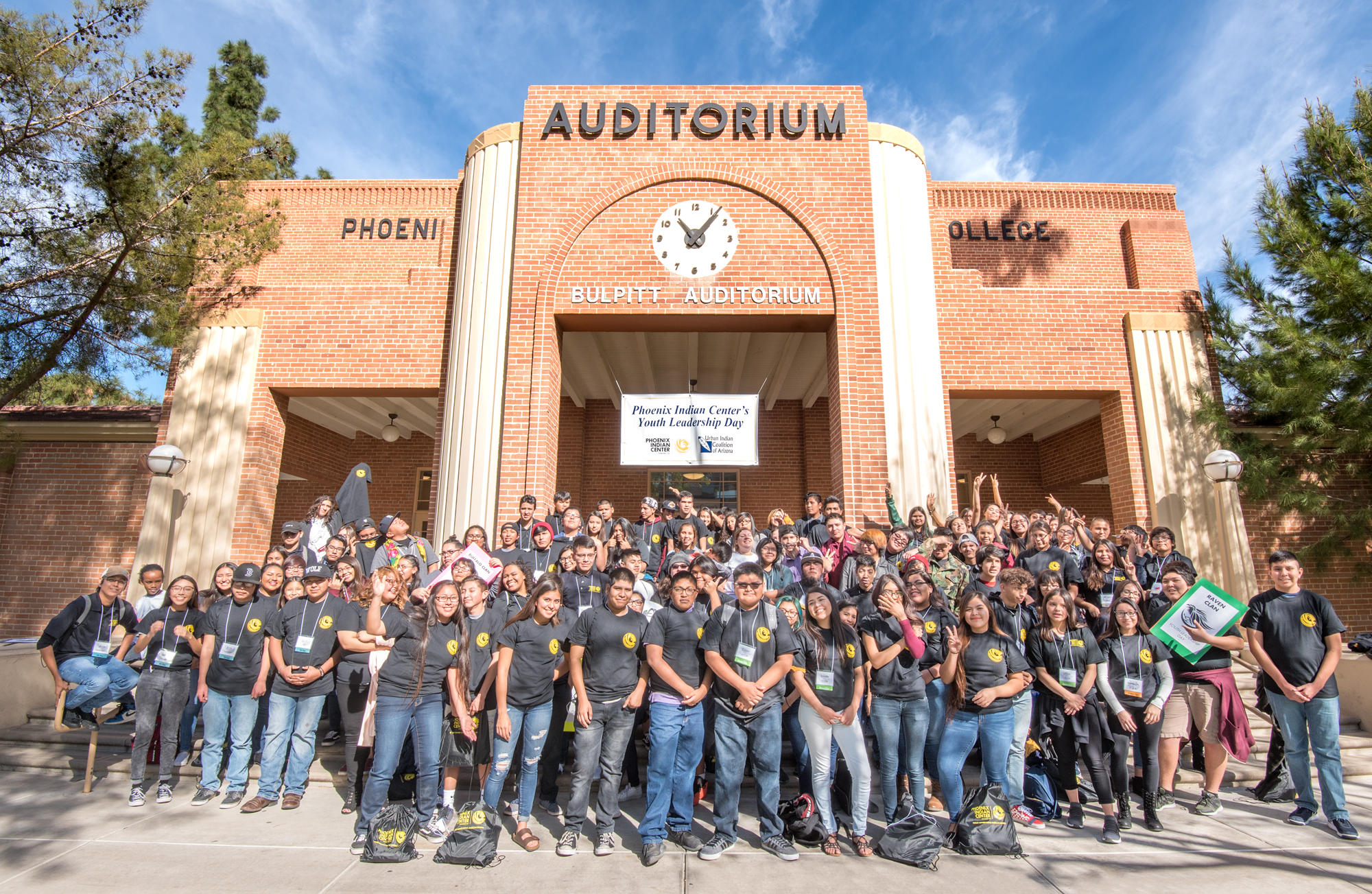Participants in the Phoenix Indian Center Youth Leadership Day pose in front of an auditorium. / Photo by Phoenix Indian Center