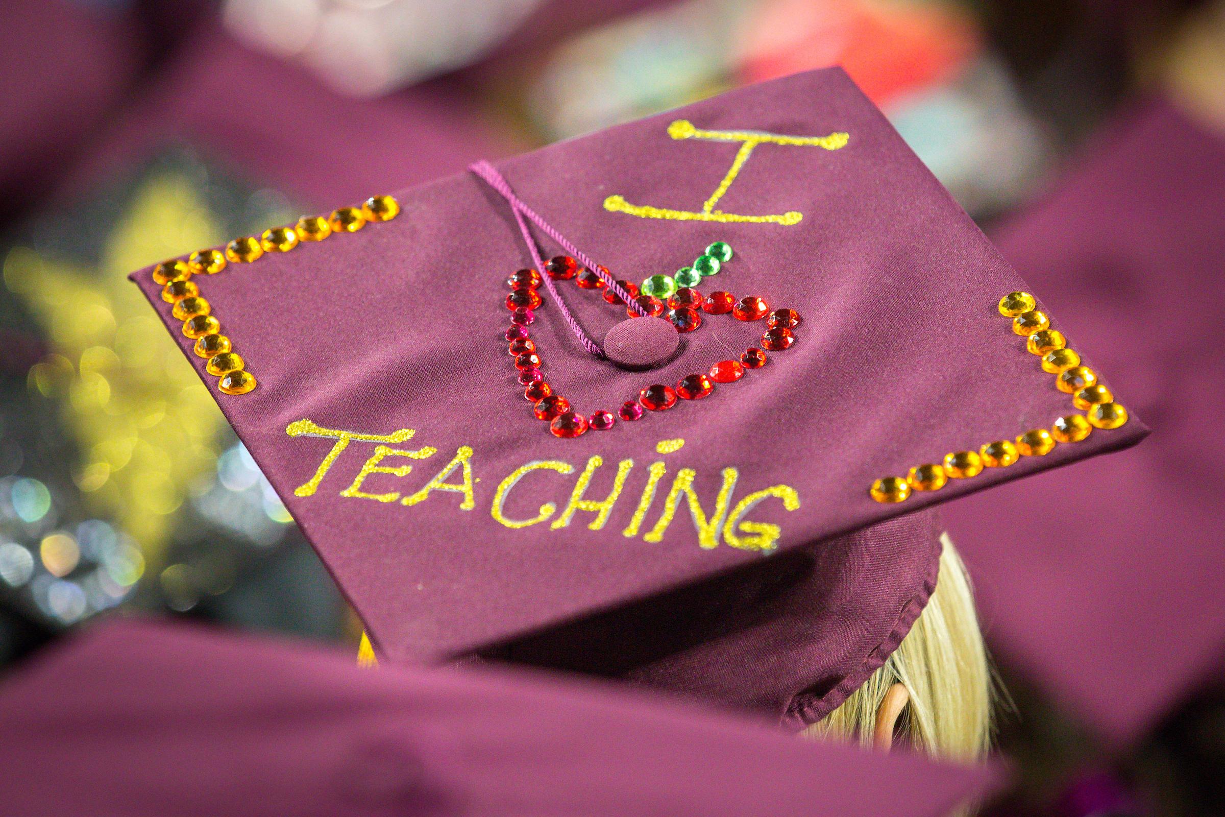 "graduation cap with ""I <3 teaching"" on it."
