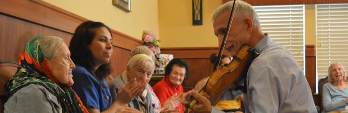 Man playing a violin for retirees
